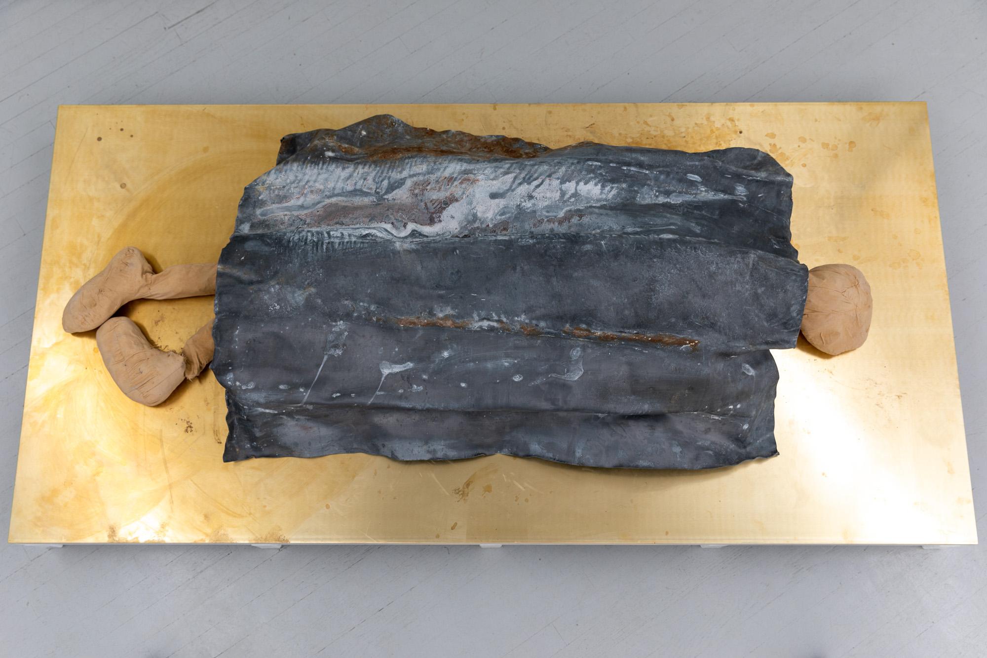 Palett Lead Sheet, 2020. Mixed media (lead, textile, clay, brass, powder-coated steel, plywood) on artist designed pedestal, 41 x 200 x 100 cm