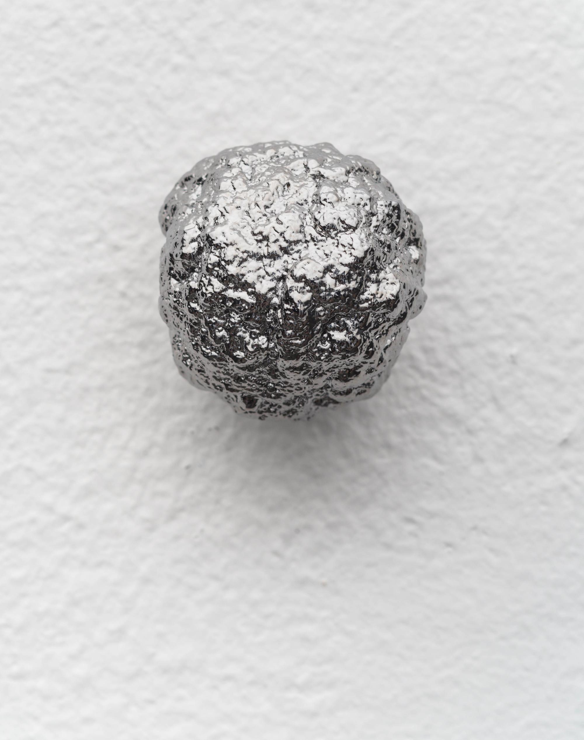 Bullet Meat Head, 2020, Chrome-plated bronze, approx. Ø 3 cm each (series of 22 unique sculptures)