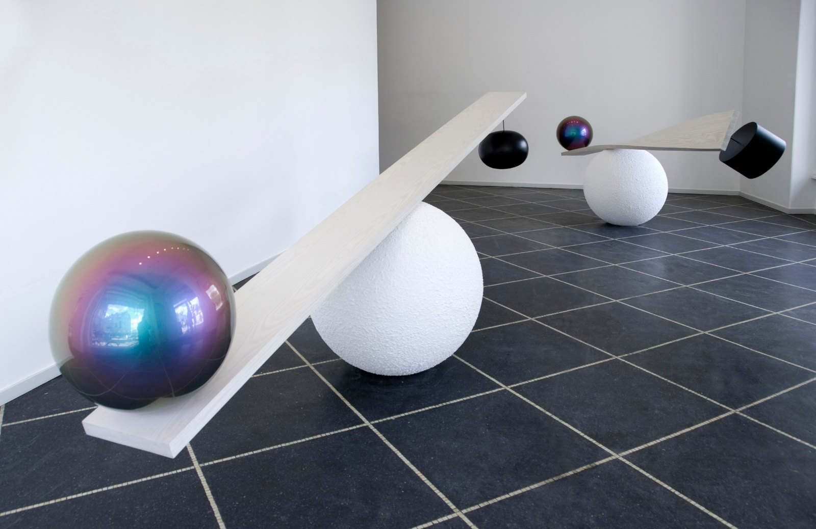 The weight of colour, 2006, polyester, iridescent paint, wood and other materials, ca 130 x 440 x 90 cm (2 pieces)