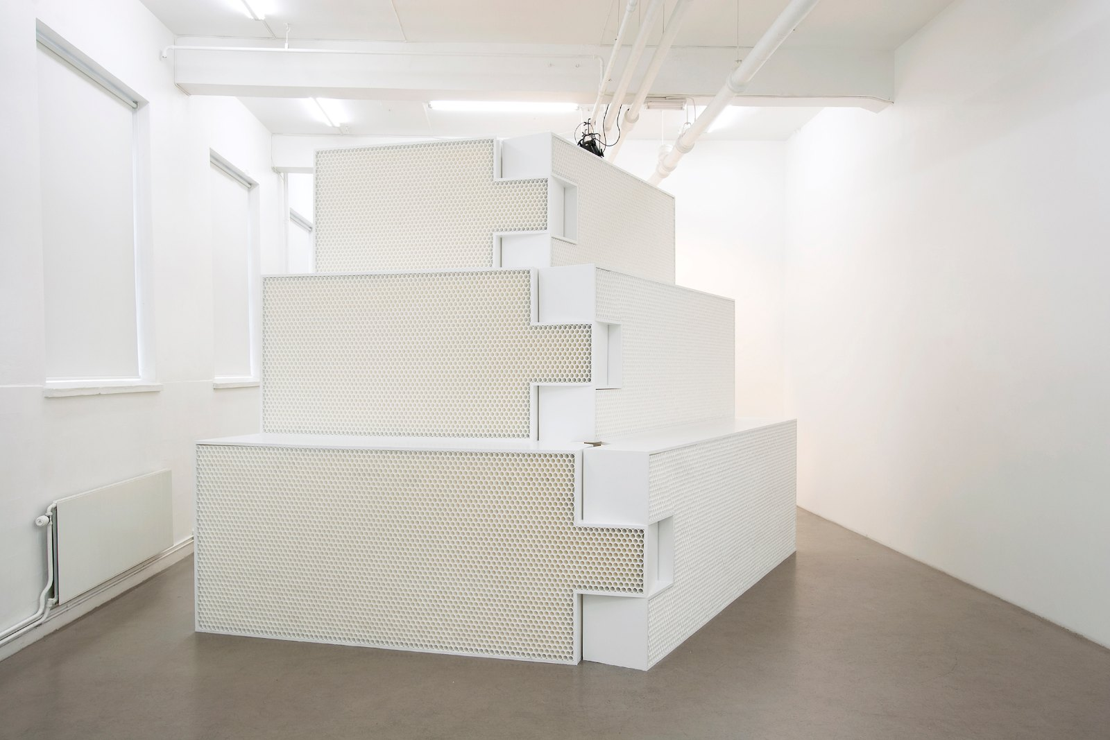 M.310, 2008, MDF boards, paint and plastic tubes, 6,5 m x 2,8 m x 3,6 m. Installation view, Marte Johnslien, 18 % Gray, 0047 Oslo, 2008