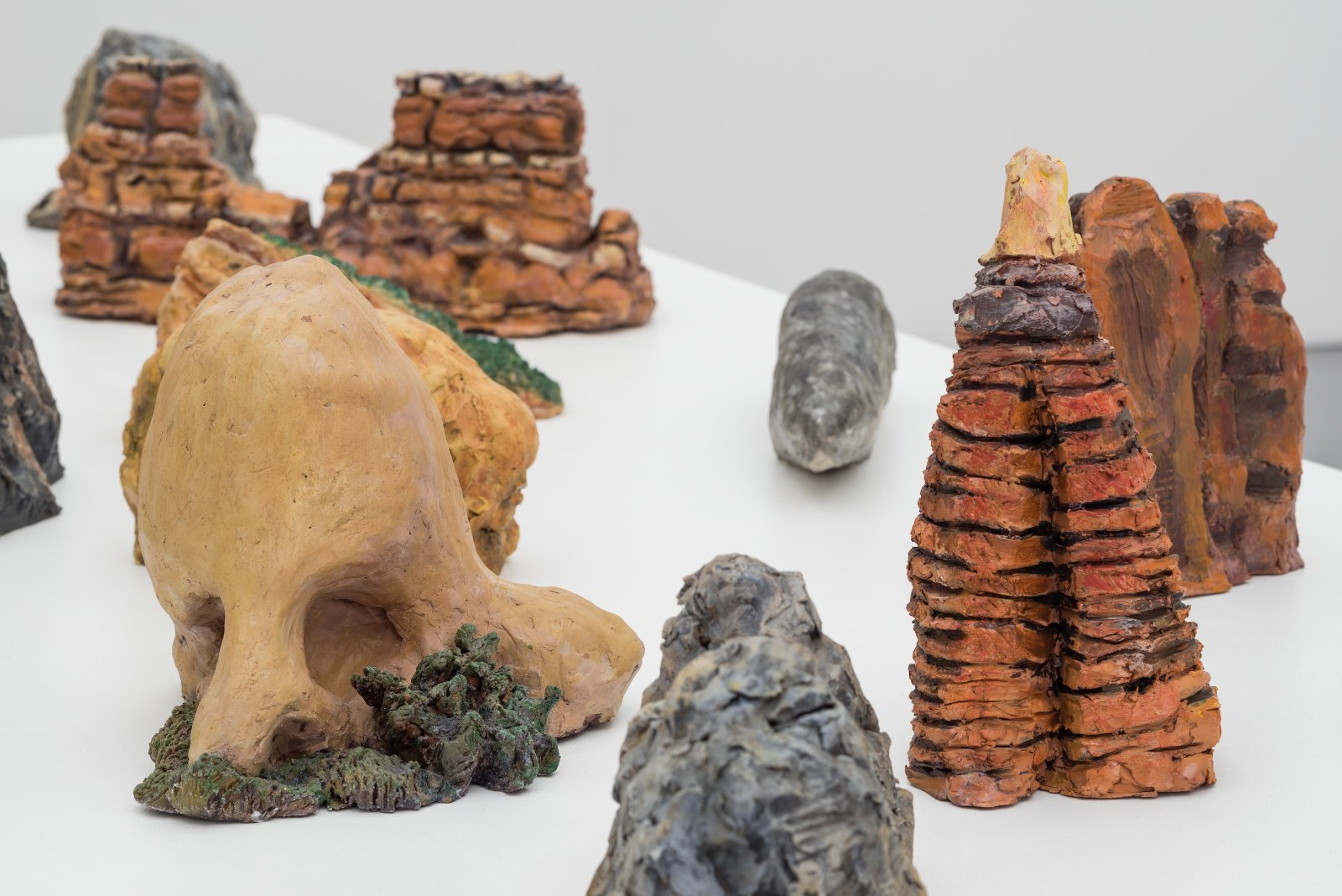 Detail of Frida Tebus', 13 Sculptures, 2009-2010, acrylic on clay, dimensions variable: Kitty Cat, Sleeping Camel, Three Penguins, Elephant Rock, Elephant Rock, Sinking Ship, Sailing Ship, Wooden Shoe, Cinderella Slipper, Chimney Rock, Cowboy Chaps, The Great Stone Face, Skull Rock