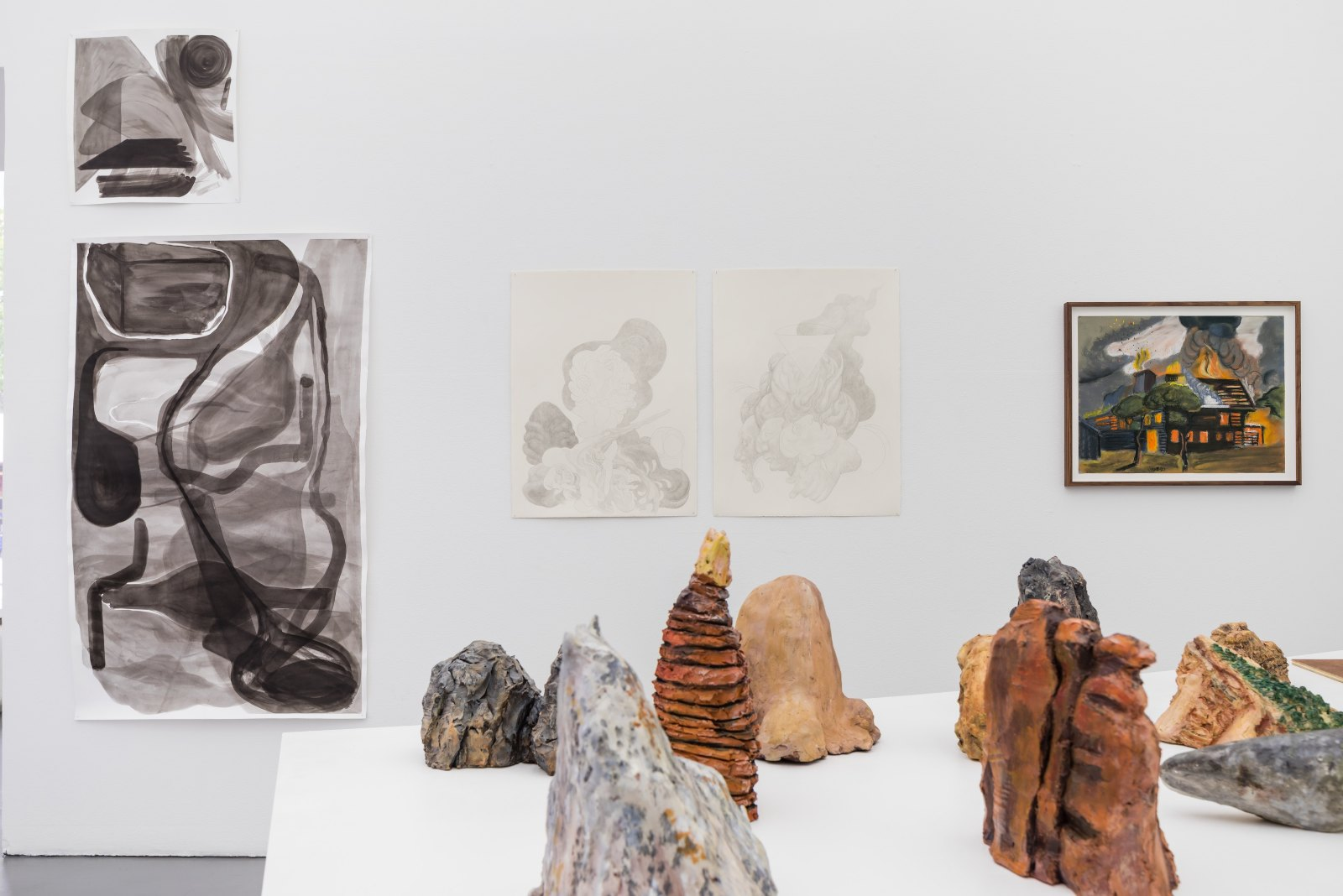 """From left: Marianne Skaarup Jakobsen, Cave, 2014, ink on paper, 55 x 54 cm. Still unknown, 2014, ink on paper, 93 x 151 cm. Andreas Kalliaridis, untitled, 2015, pencil on paper, 56 x 76 cm / Untitled, 2015, pencil on paper, 56 x 76 cm. Olle Wärnbäck, Sång 2, 2015, crayon on paper, 63 x 48 cm. Frida Tebus, Detail of """"13 Sculptures"""", 2009-2010, acrylic on clay, dimensions variable"""