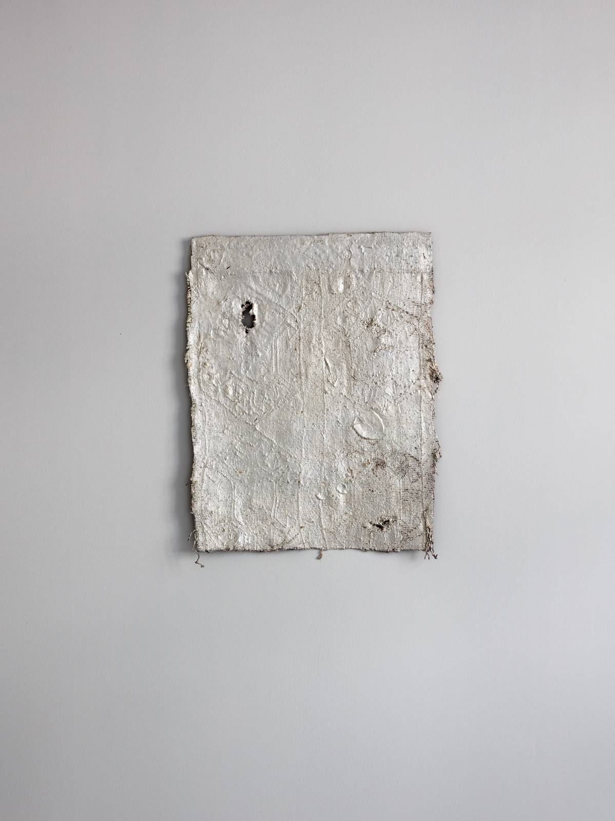 David Tibet (braille dogs hammering out belonging to the sky), 2017, anatolian yastik, rubber, silverleaf, lacquer, 63 x 49 cm