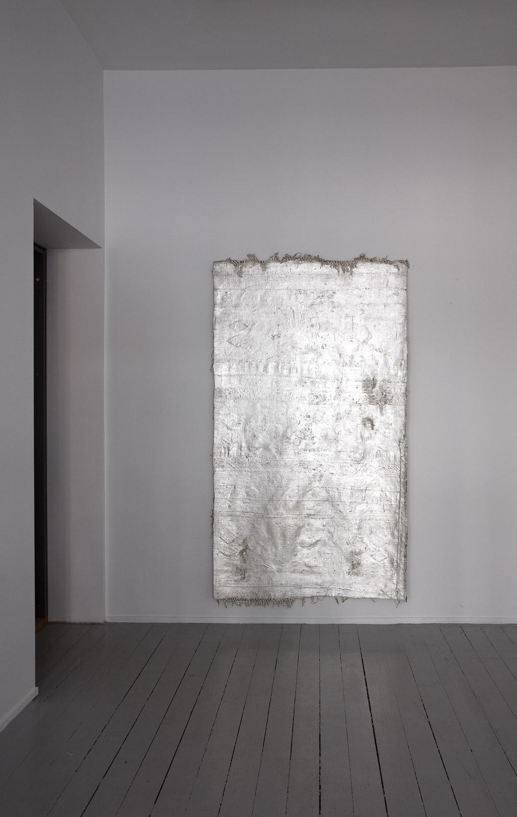 Martin Erik Andersen, Al-mulk, 2017, Anatolian rug, rubber, silverleaf, lacquer, 220 x 119 cm