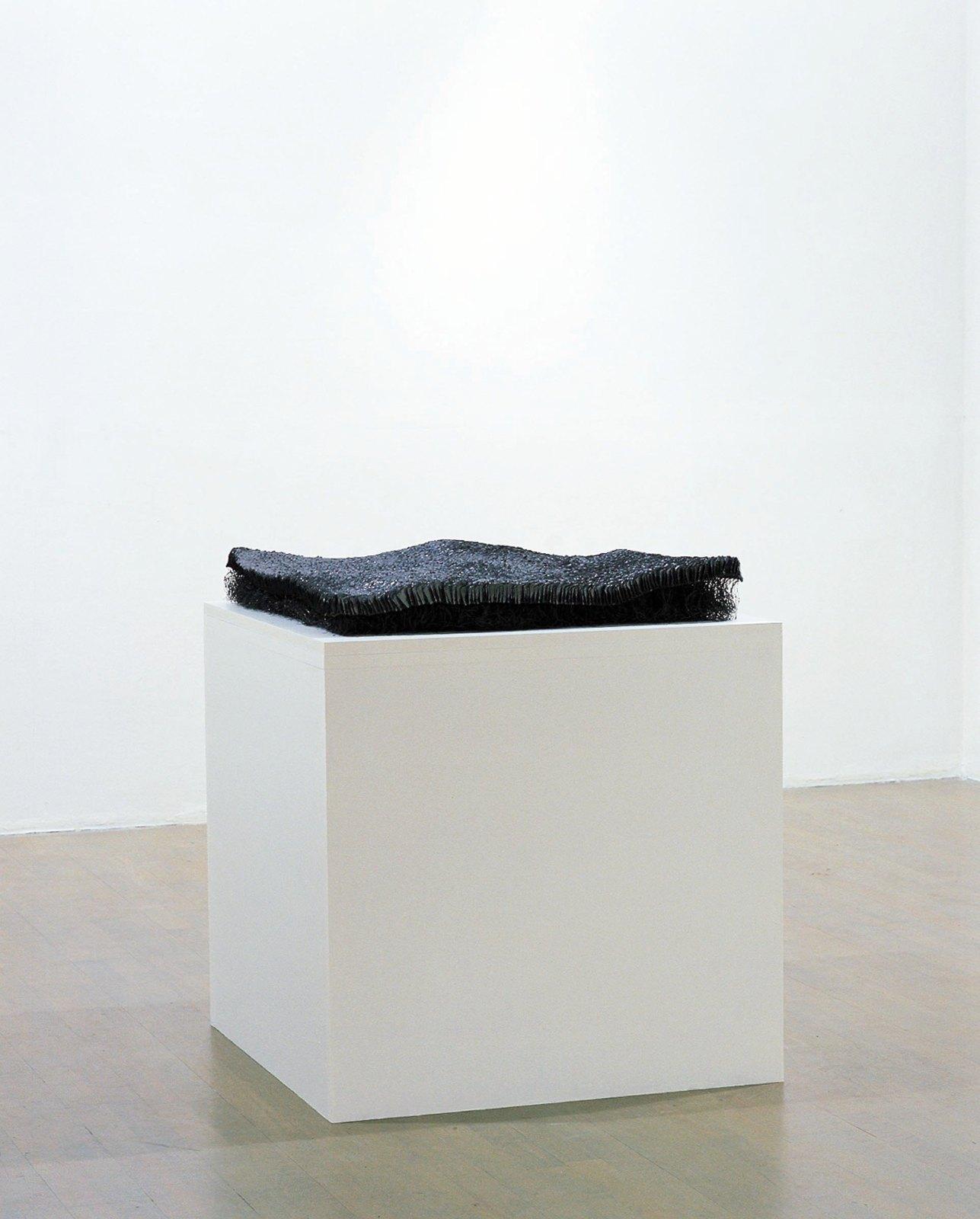Sculpture I, 1998-99, lead, steel, 10 x 70 x 70 cm