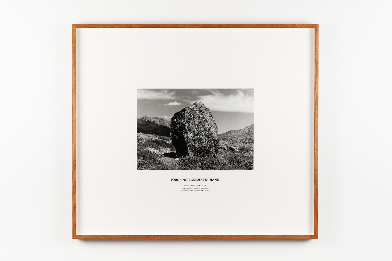 Touching Boulders by Hand. A 28 Day Resupplied Walk 1-28 July, 28 Nights Camping All Within Jotunheimen, Norway During the Hot Dry Summer of 2018. Silver gelatin photographic print with pressed lettering walk text on museum board in artists frame, 84 x 96 x 4,8 cm. Unique